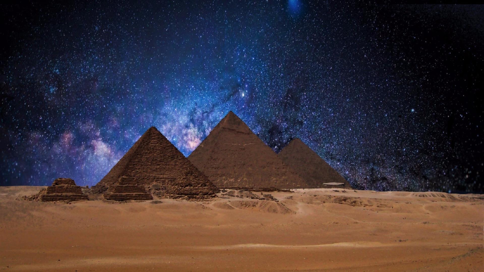 Egyptian Pyramids at night wallpaper