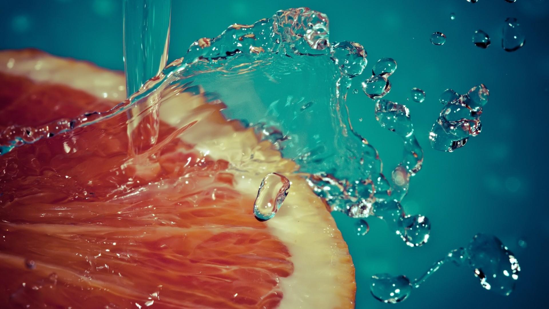 Waterdrops on orange wallpaper