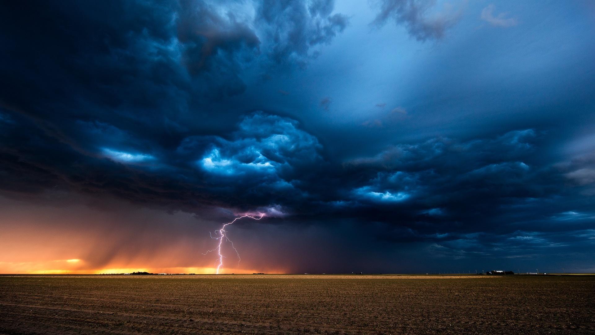 Thunderstorm in the field wallpaper