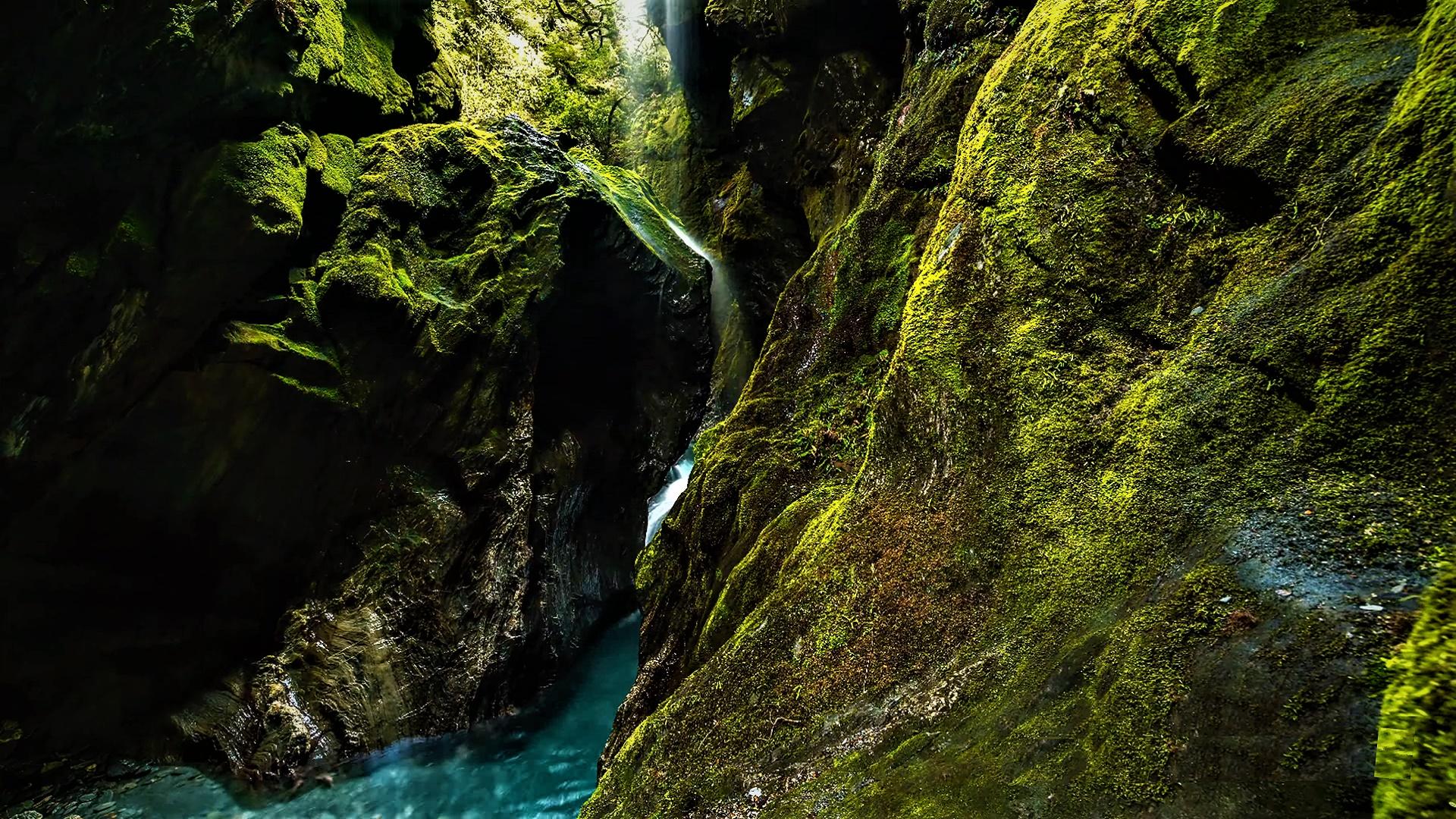 Waterfall among the mossy rocks wallpaper