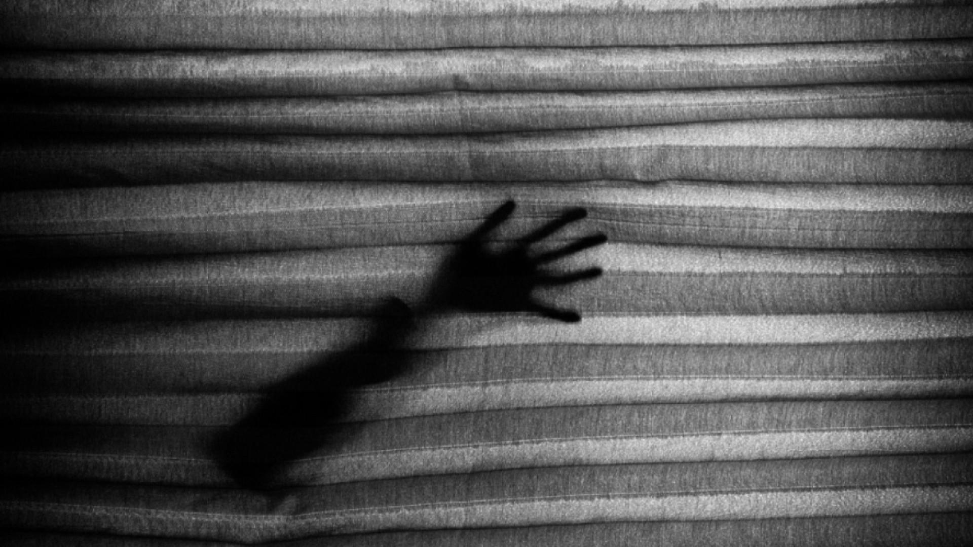 Black shadow of arm wallpaper