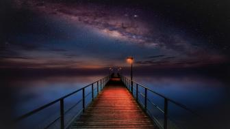 Pier on a starry night wallpaper