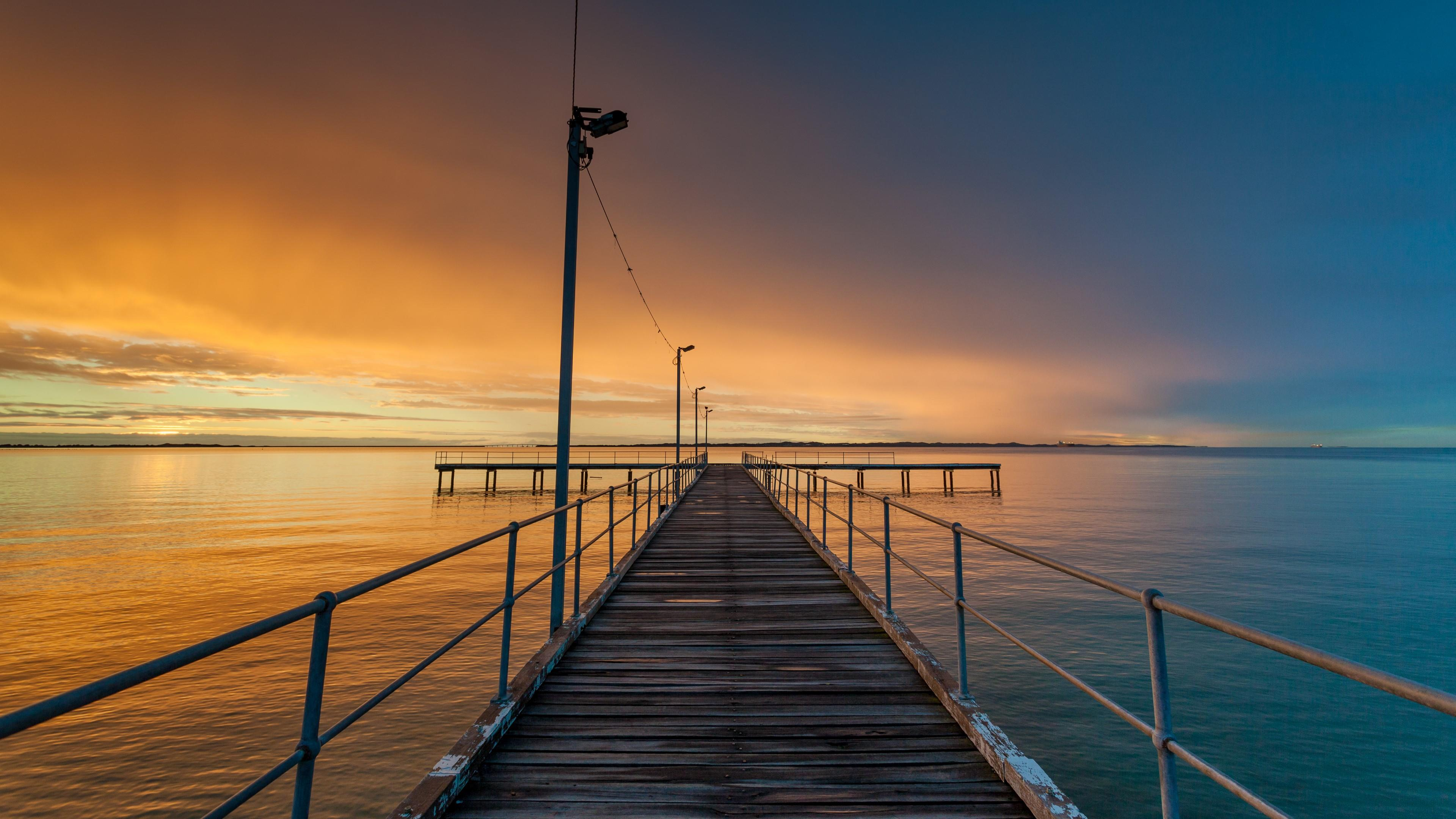 Sunset at the fishing pier wallpaper