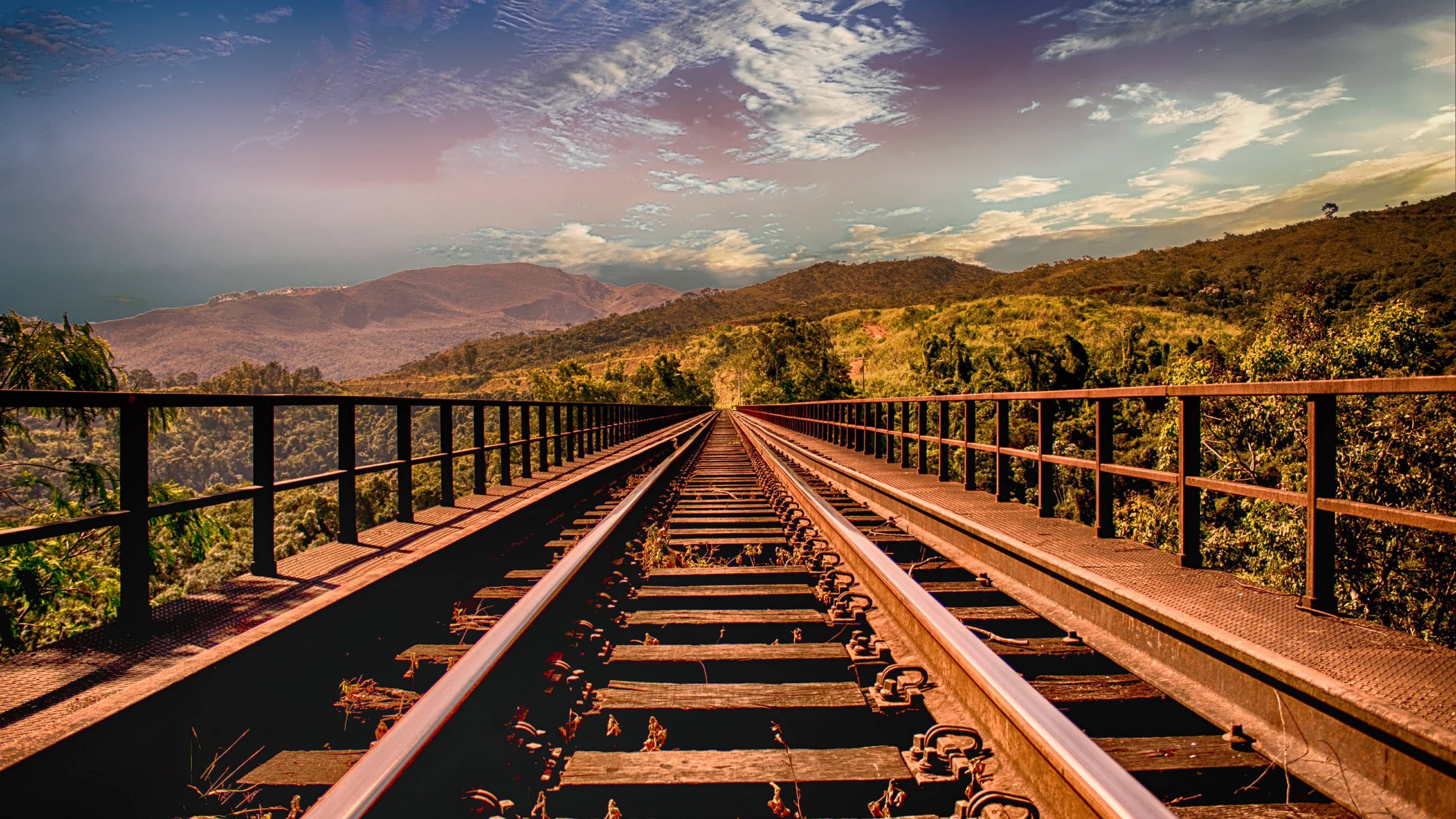 Railway track in mountains wallpaper