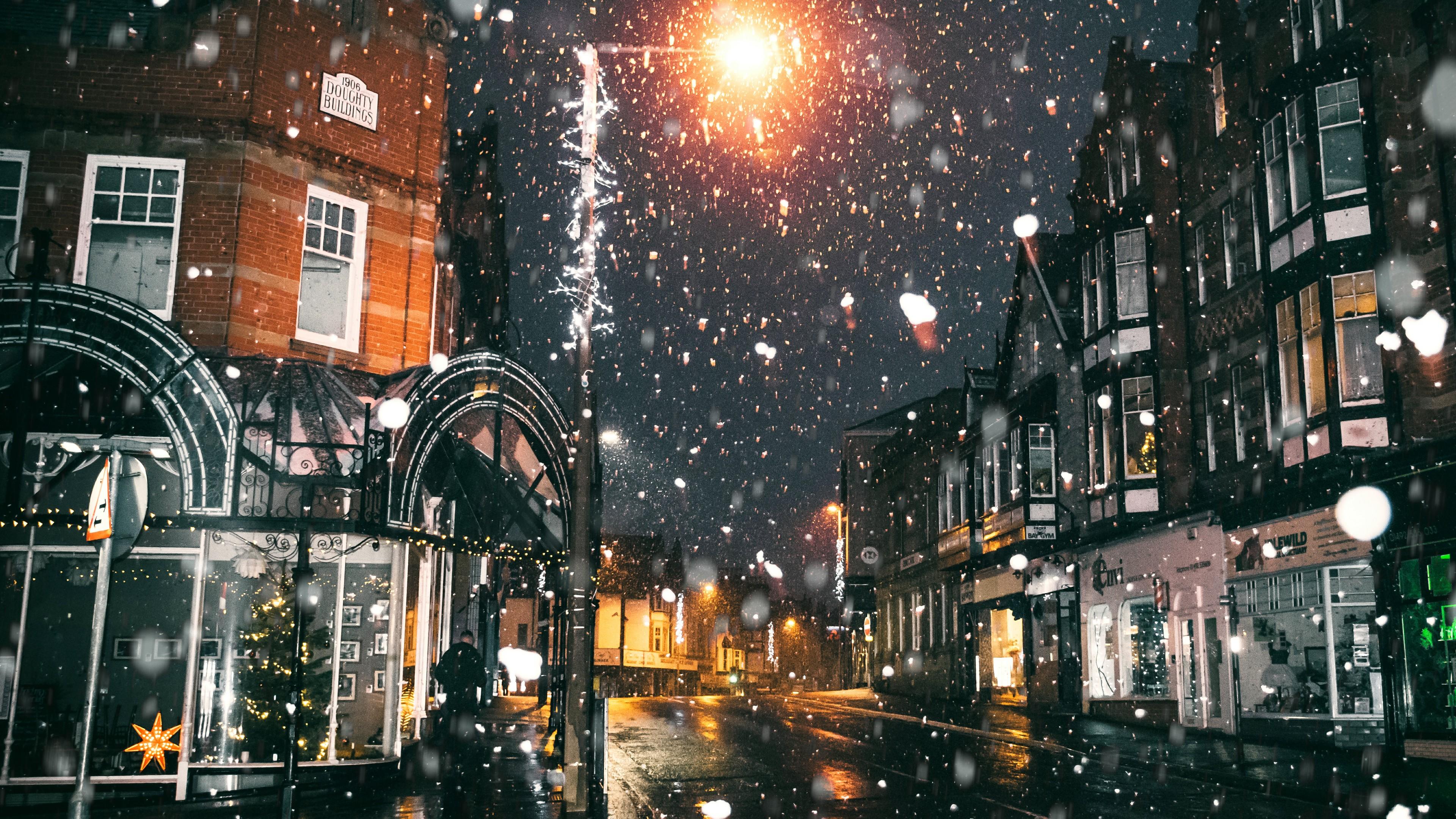 Snowfall in a town wallpaper