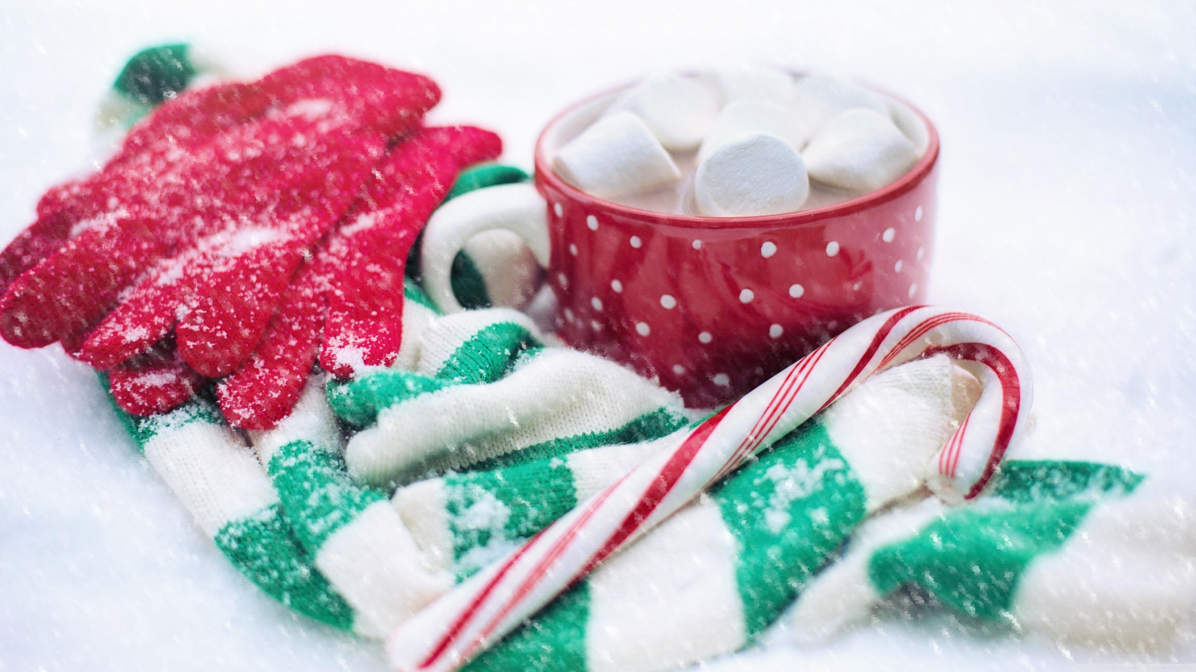 Hot chocolate and candy cane in the snow wallpaper