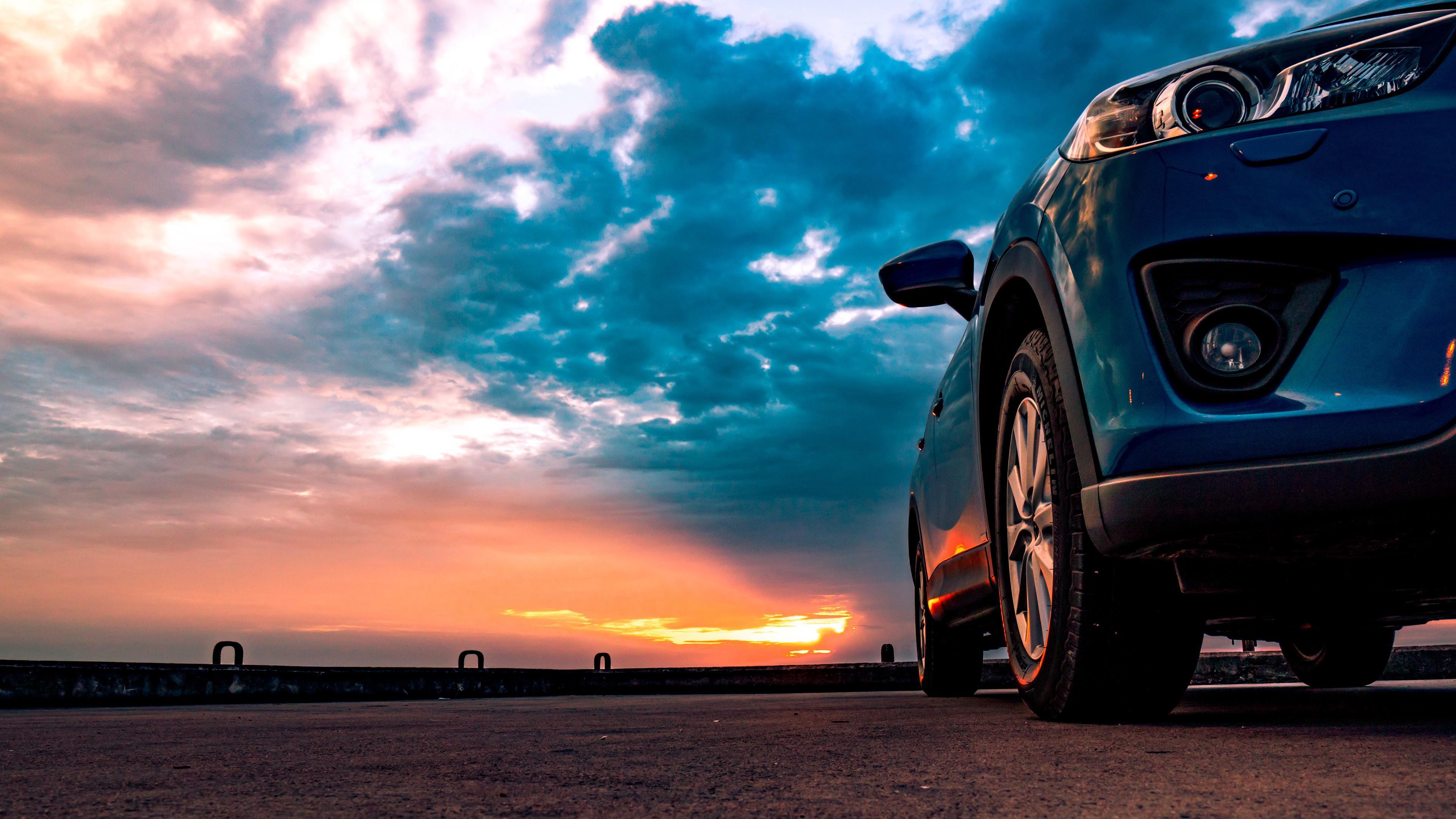 Sports car at sunset wallpaper