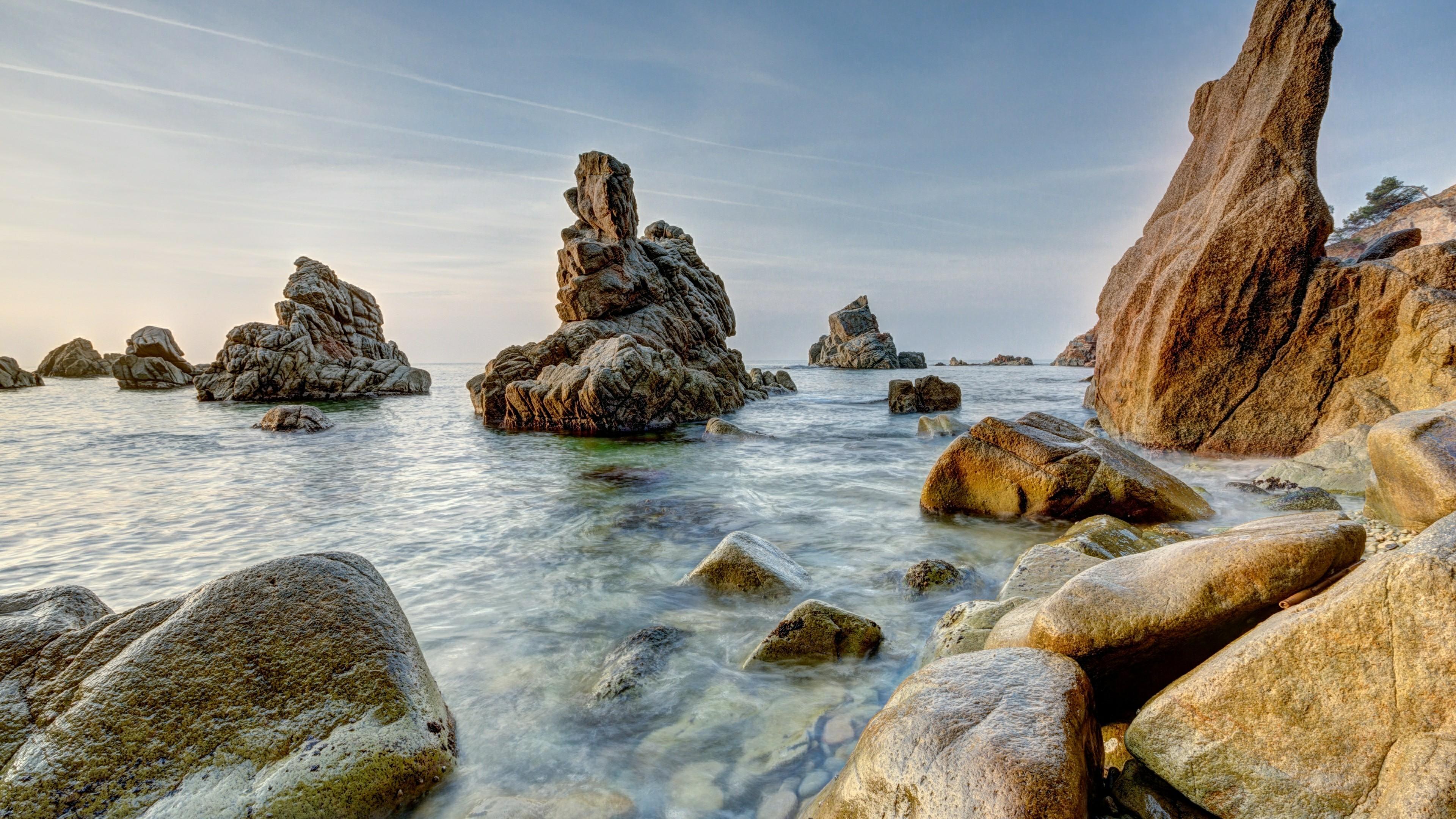 Outcrop boulders at Cala dels Frares wallpaper
