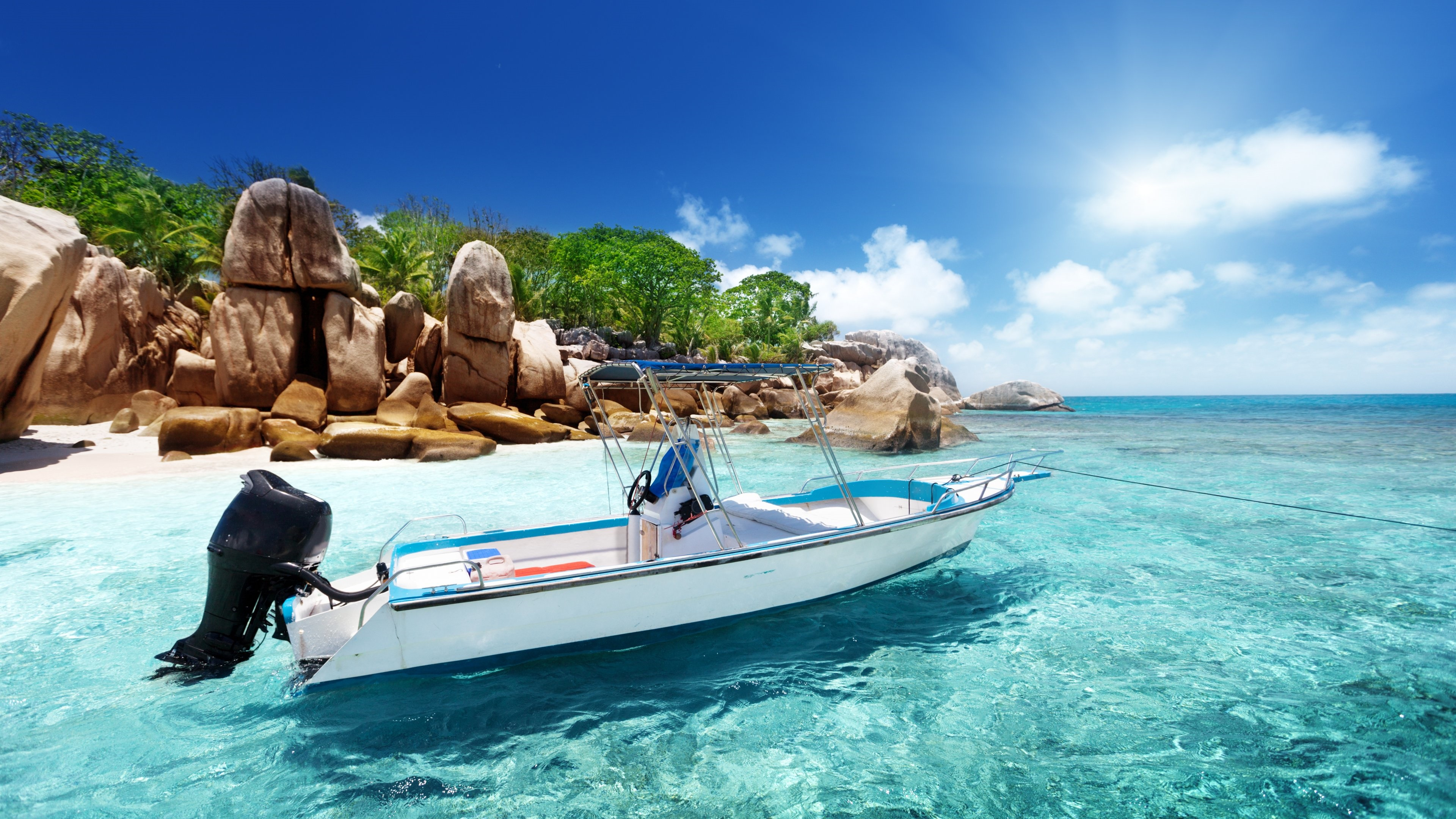 Motorboat on the crystal clear water wallpaper