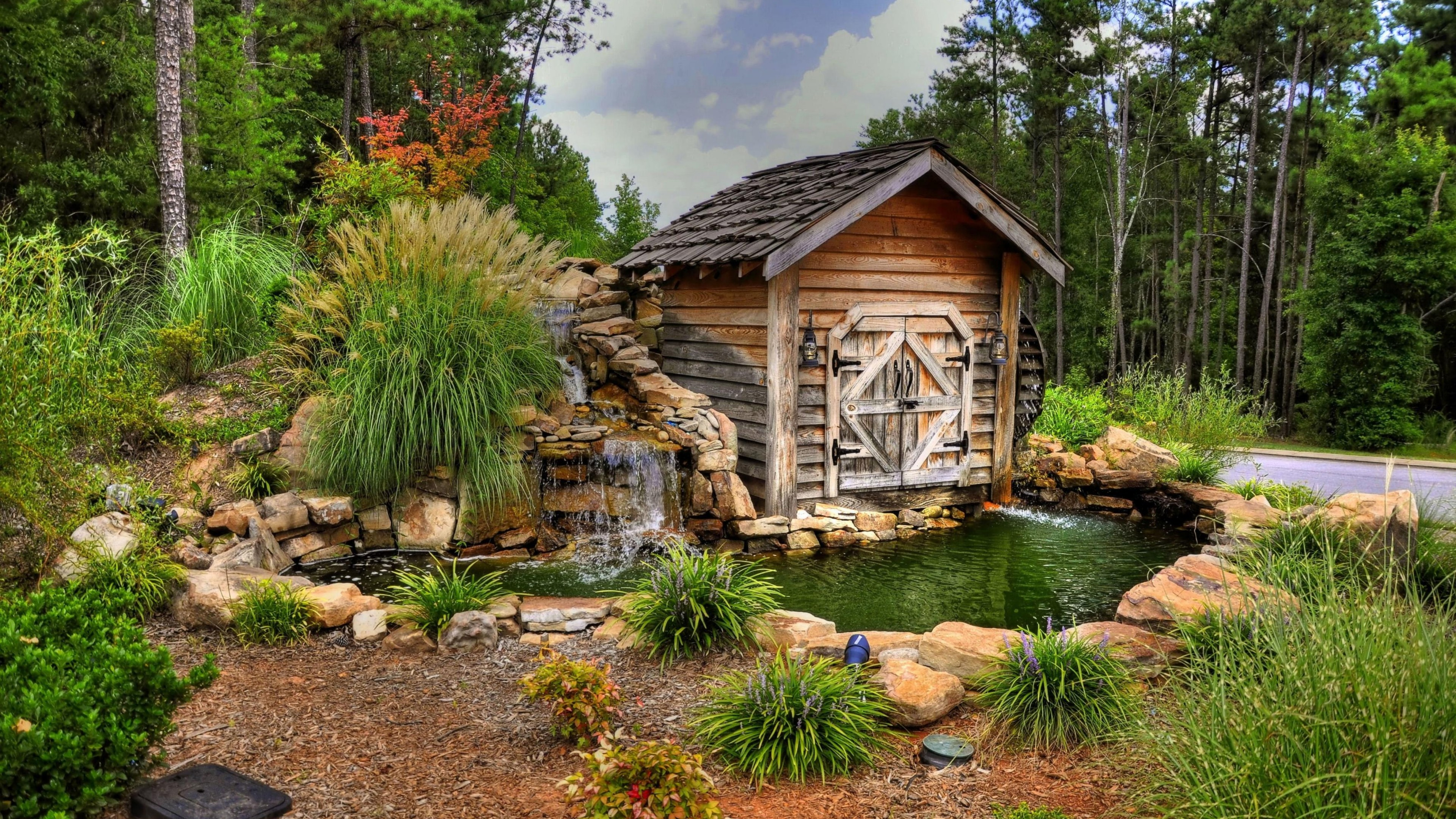 Watermill with a small pond wallpaper