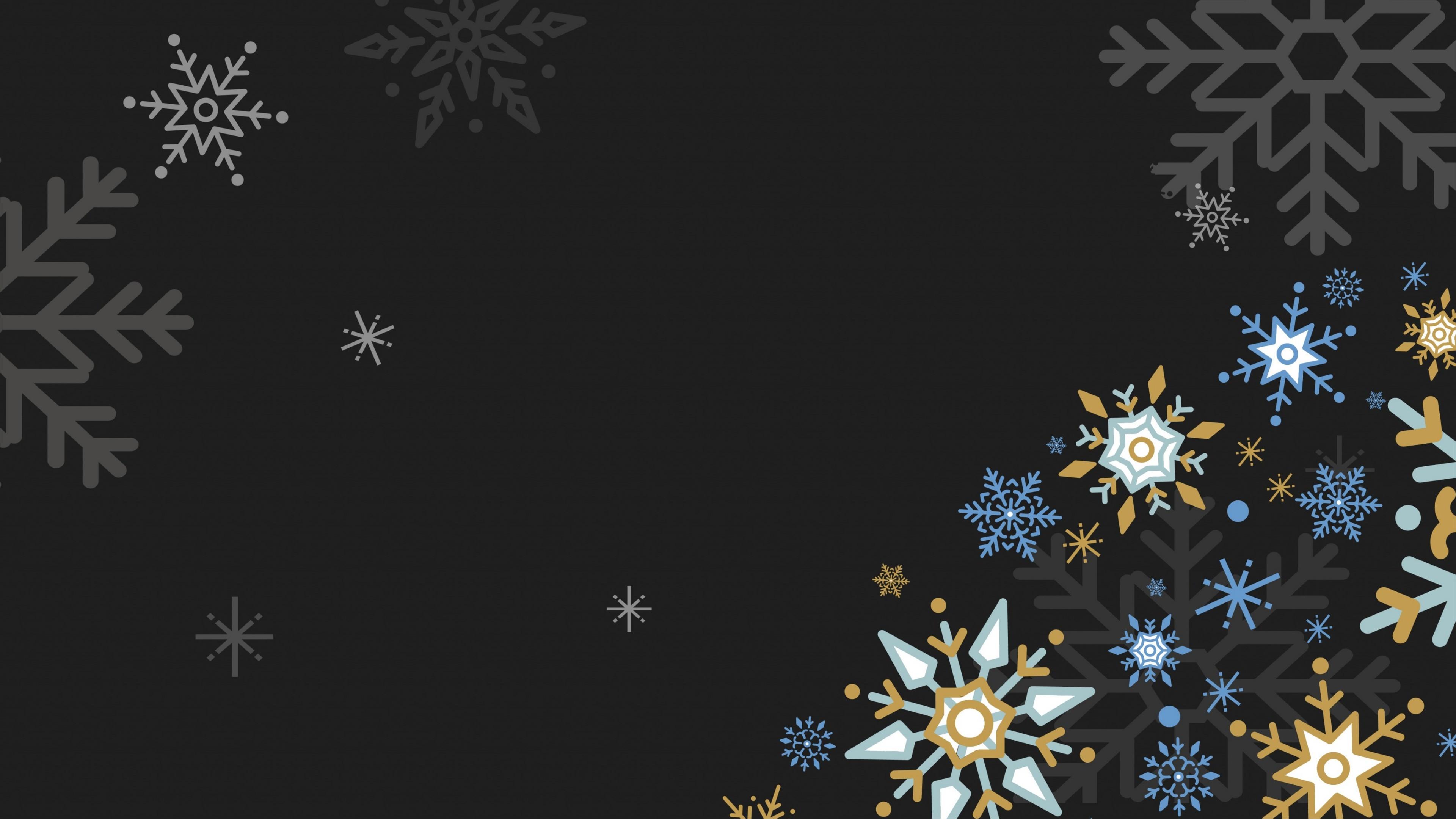 Snowflakes on dark background wallpaper