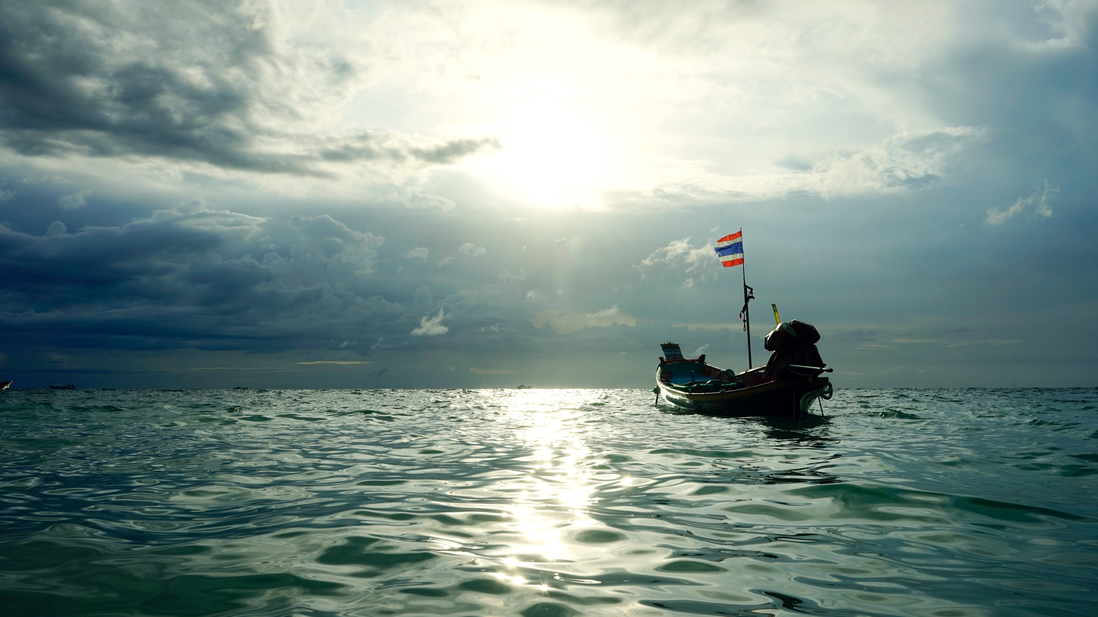 Floating boat wallpaper