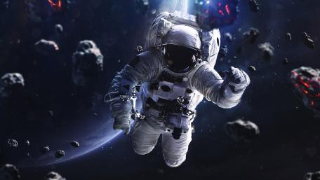 Astronaut floating around asteroids wallpaper