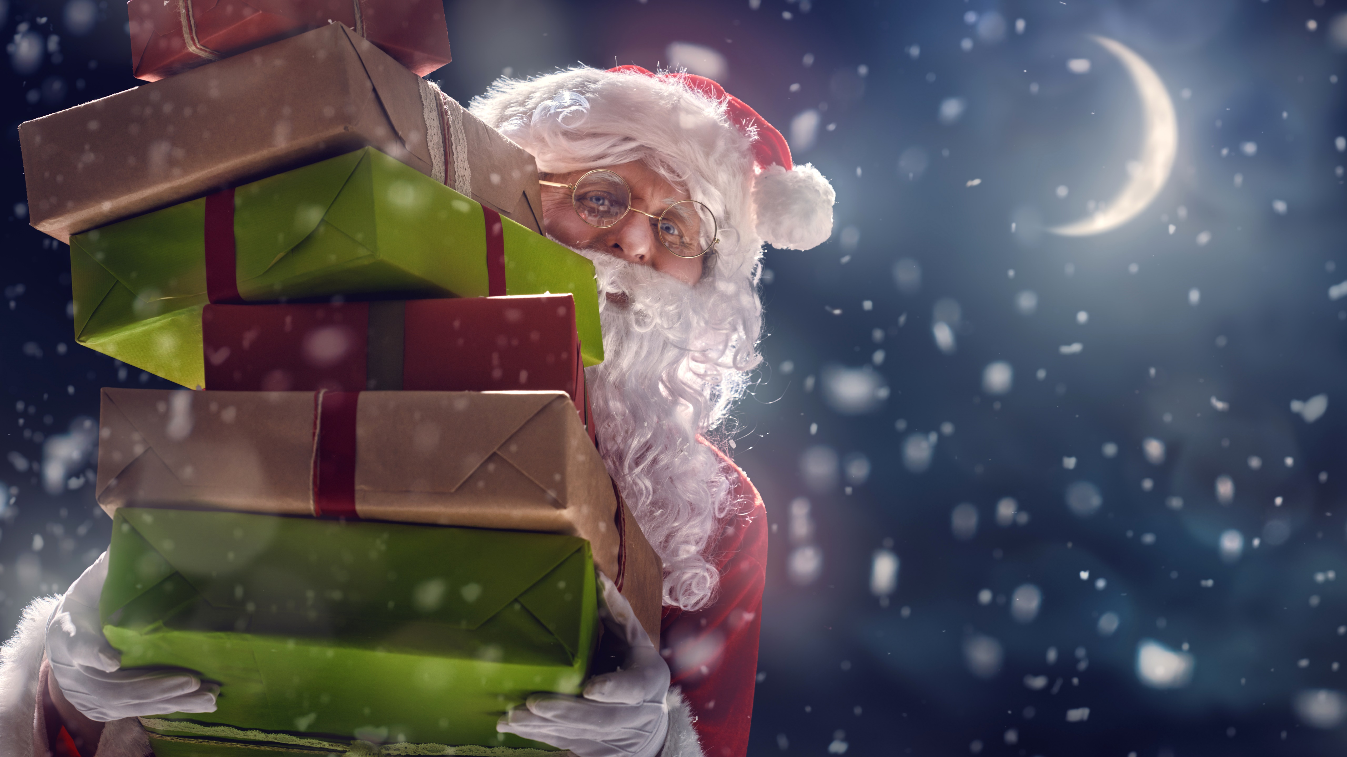 Santa Claus with gifts wallpaper