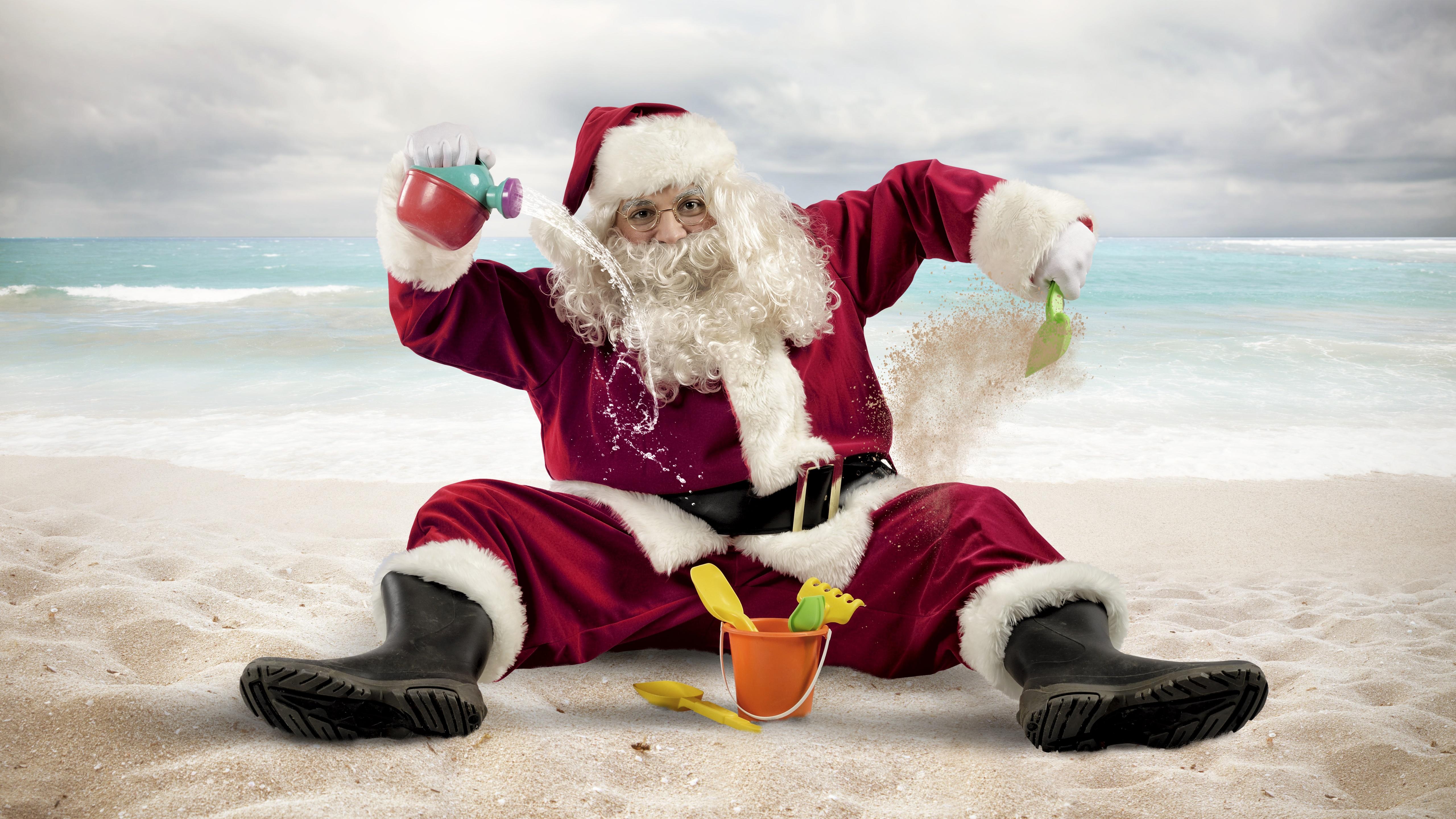 Funny Santa on the beach wallpaper