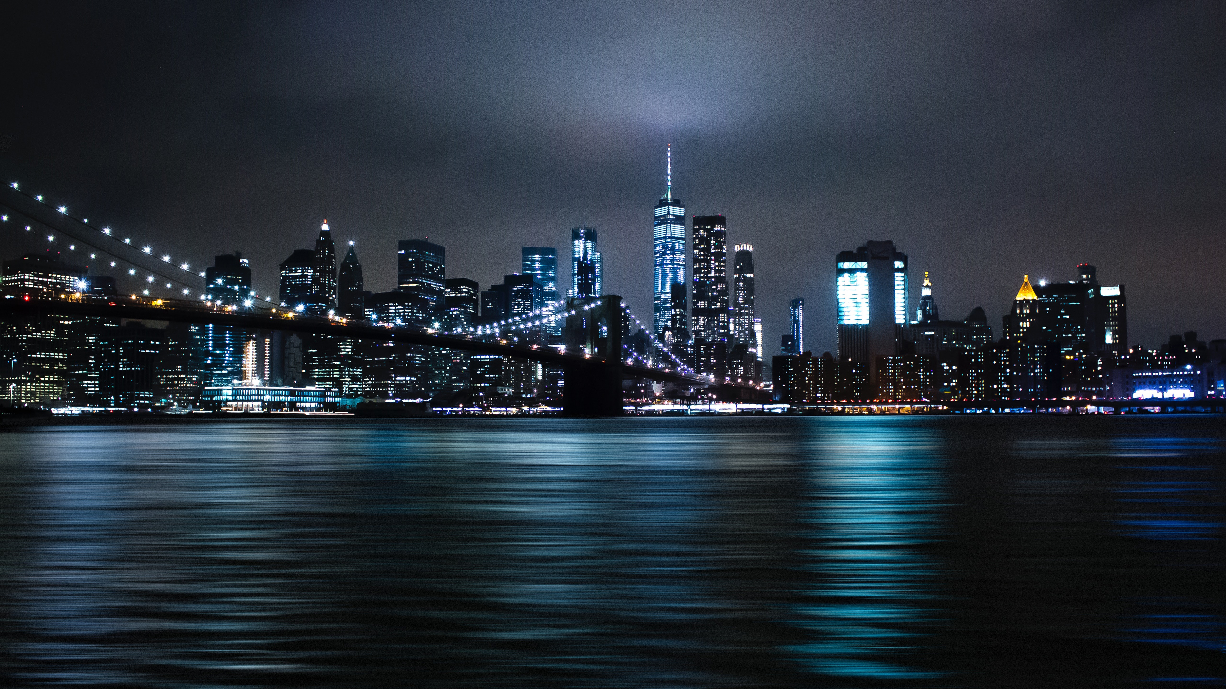 The Brooklyn Bridge and the Empire State Building at night wallpaper