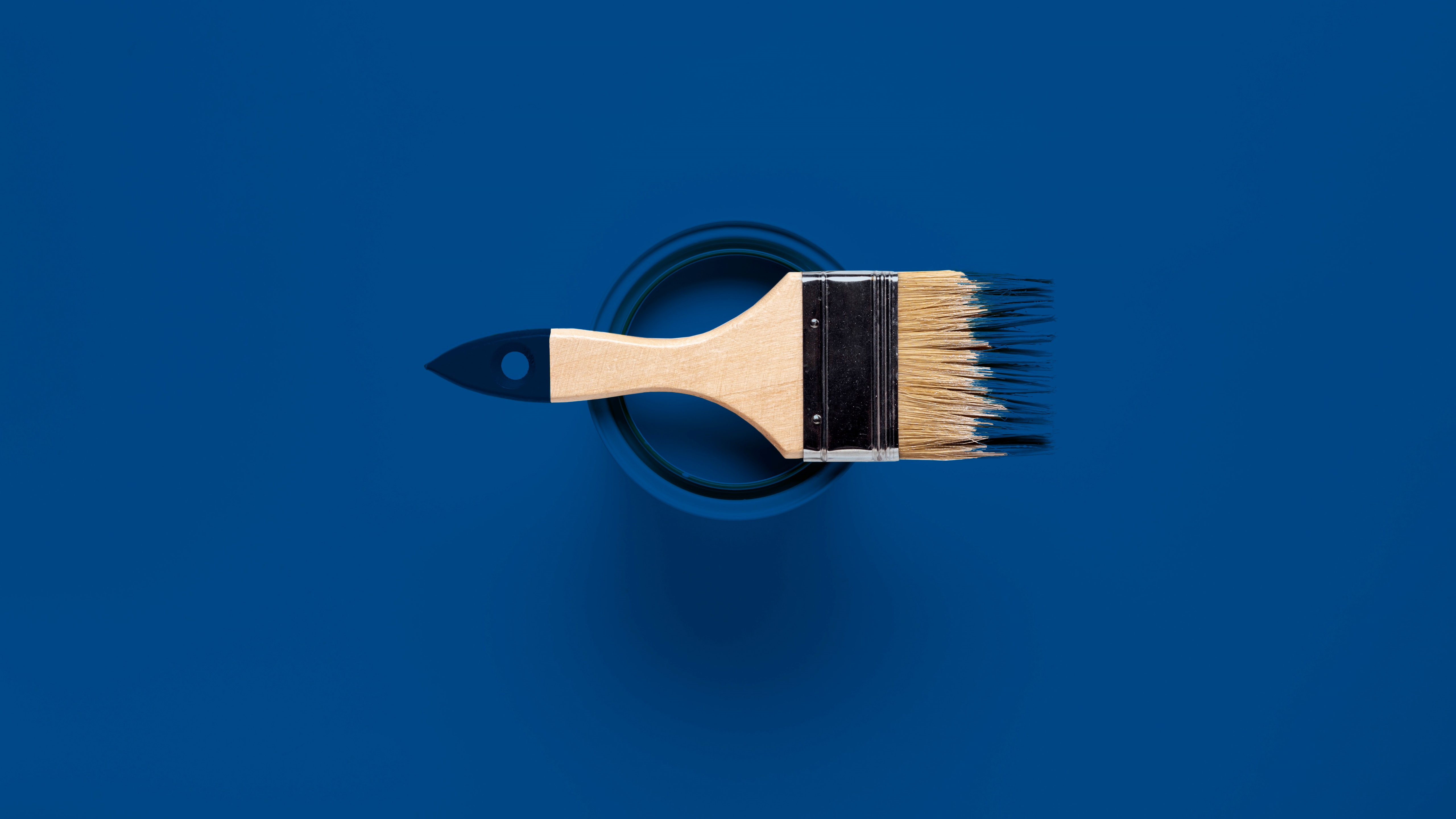 top view of brush and paint can wallpaper