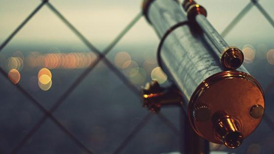 Telescope with bokeh lights wallpaper