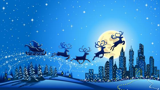 Santa Claus flying over the city wallpaper