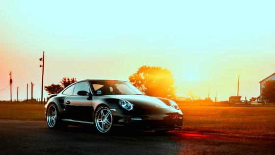 Porshe in the sunset wallpaper