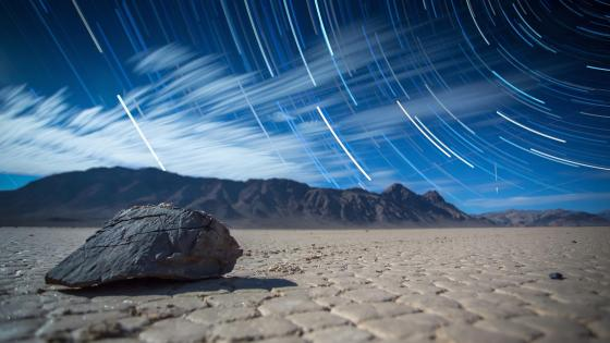 Star trails over Racetrack Playa wallpaper