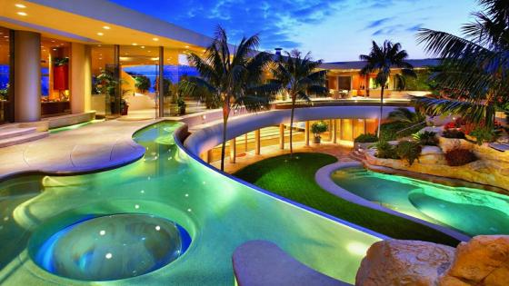 Swimming pools and palms wallpaper