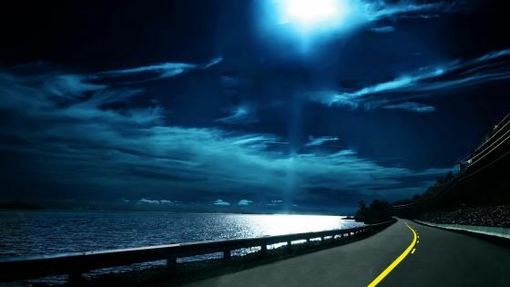 Moonlight over the road wallpaper
