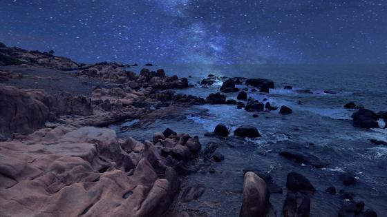 Rocky coast side with milky way wallpaper