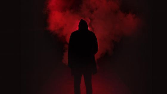 Man silhouette in the dark wallpaper