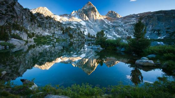 Mountains reflected in the crystal clear water wallpaper