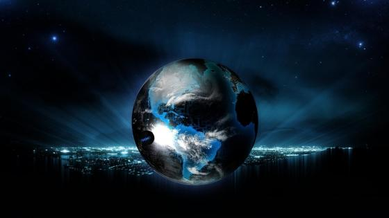 Earth globe over the city lights wallpaper