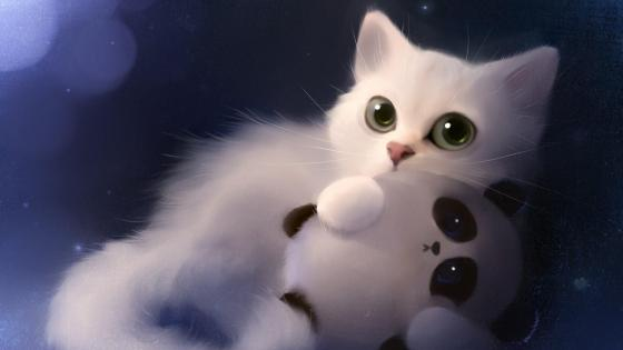 Fluffy white kitten with panda wallpaper