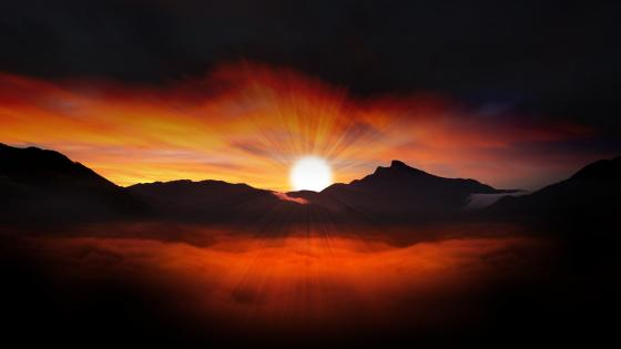 Sunset over the mountain range wallpaper