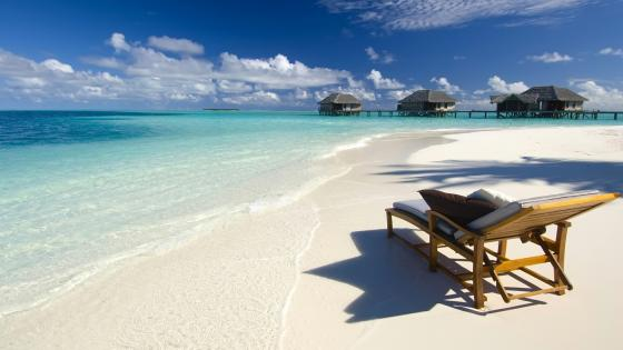 Sunbed in the beach wallpaper