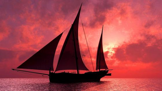 Sailboat in the sea under the cloudy sunset wallpaper