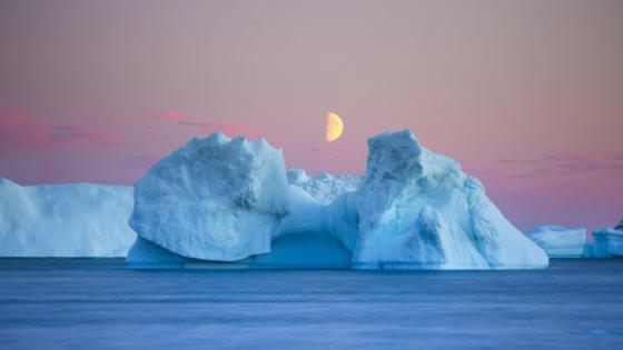 Half moon over the iceberg  wallpaper