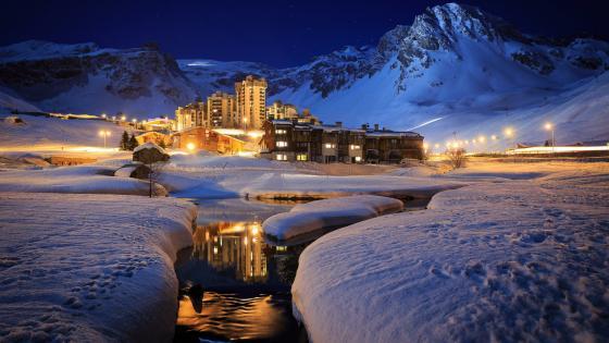 Luxury ski resort at night in Tignes, France wallpaper
