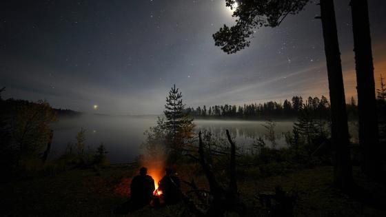 Firelight under the starry night wallpaper