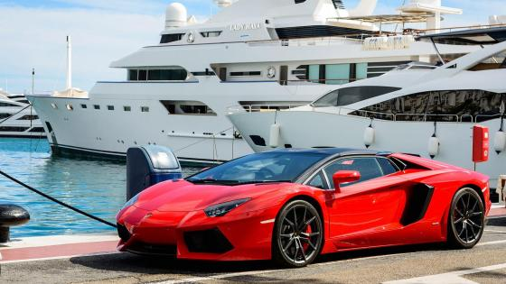 Red Lamborghini Against Large White Yatch wallpaper