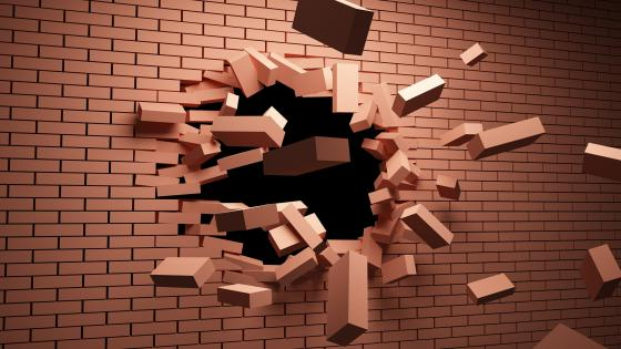 3D Exploding brick wall wallpaper