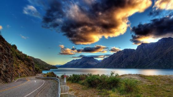 Road along the mountain lake wallpaper