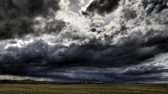 Stormy clouds above the field wallpaper