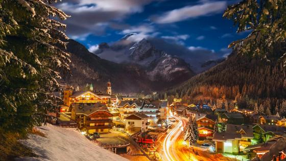 Canazei ski resort on a winter evening - Italy wallpaper