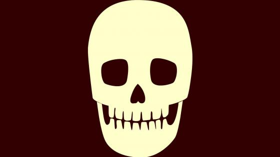 Grinning orange skull wallpaper
