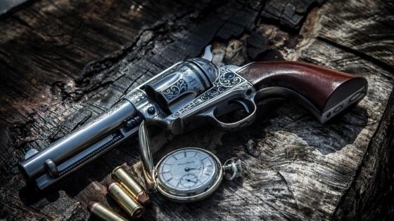 Pocket watch and an antique revolver wallpaper