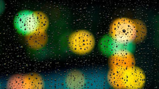 Raindrops on the window with bokeh lights wallpaper