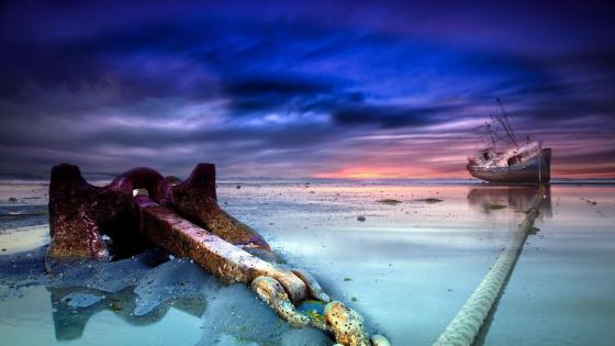 Anchored ship after tide wallpaper