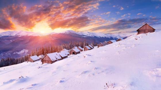 Snowy mountain town wallpaper