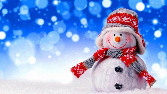 Christmas snowman as a festive sign wallpaper