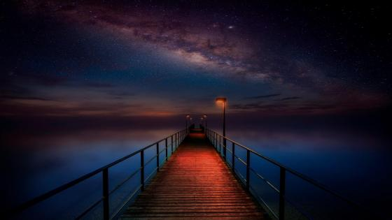 Long pier under the Milky Way wallpaper